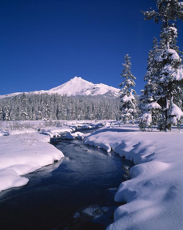 Soda Creek flows through snow fields below Broken Top, Cascades Range, Oregon.