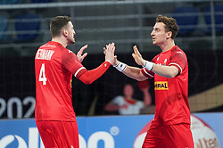 14.01.2021, 6th of October Sports Hall, Gizeh, EGY, IHF WM 2021, Österreich vs Schweiz, Herren, Gruppe E, im Bild Maximilian Hermann, Lukas Herburger, // during the IHF men's World Championship group E match between Austria and Switzerland at the 6th of October Sports Hall in Gizeh, Egypt on 2021/01/14. EXPA Pictures © 2020, PhotoCredit: EXPA/ Diener/Eva Manhart<br /> <br /> *****ATTENTION - OUT of AUT and SUI*****
