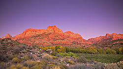 Zion's Watchman after sunset just south of Springdale Utah outside of Zion National Park.<br /> <br /> I think that some of the true magic of southwestern light is long after the sun goes down. some of these peaks have a residual glow after the sun is gone as if the red sandstone is a magnet for residual warm light in the upper atmosphere. A number of times I have been waiting to the sun to hit the mountains for that kiss of warm light and this wonderful pre-dawn of after sunset glow was gone.