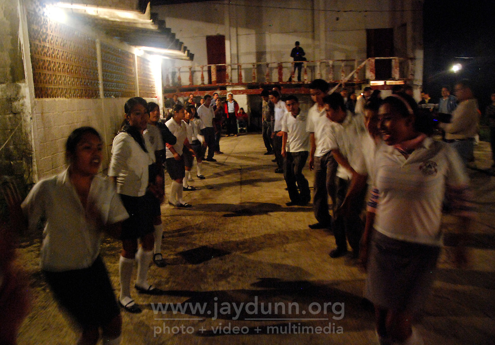 """MEXICO, Veracruz, Tantoyuca, Oct 27- Nov 4, 2009. Night """"cuadrillo"""" practice behind the Tantoyuca dance studio of Marcelo Rodriguez Ordaz. """"Xantolo,"""" the Nahuatl word for """"Santos,"""" or holy, marks a week-long period during which the whole Huasteca region of northern Veracruz state prepares for """"Dia de los Muertos,"""" the Day of the Dead. For children on the nights of October 31st and adults on November 1st, there is costumed dancing in the streets, and a carnival atmosphere, while Mexican families also honor the yearly return of the souls of their relatives at home and in the graveyards, with flower-bedecked altars and the foods their loved ones preferred in life. Photographs for HOY by Jay Dunn."""