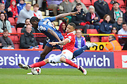 Charlton Athletic midfielder and captain, Jordan Cousins (8) making a tackle on Birmingham City striker, Clayton Donaldson (9) during the Sky Bet Championship match between Charlton Athletic and Birmingham City at The Valley, London, England on 2 April 2016. Photo by Matthew Redman.