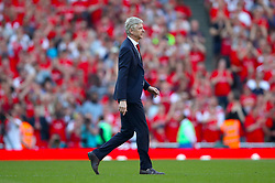 Arsenal manager Arsene Wenger on the pitch after the final whistle