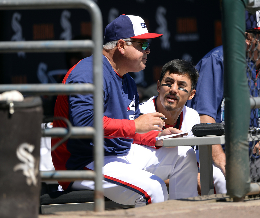 CHICAGO - APRIL 23:  Manager Rick Renteria #17 and Tyler Saladino #20 of the Chicago White Sox carry on a discussion in the dugout during the game against the Cleveland Indians on April 23, 2017 at Guaranteed Rate Field in Chicago, Illinois.  The White Sox defeated the Indians 6-2.  (Photo by Ron Vesely)   Subject:  Rick Renteria; Omar Narvaez