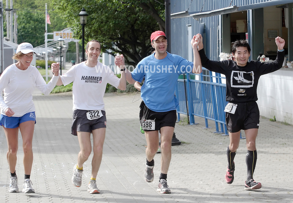 Augusta, New Jersey - Liz Bauer, Byron Lane, Shiran Kochavi and Tatsunori Suzuki cross the finish line together during the 3 Days at the Fair races at Sussex County Fairgrounds on May 16, 2010.