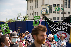 London, UK. 5th June, 2021. Environmental activists and local residents pass the Lyle's Golden Syrup Factory at Plaistow Wharf as they protest against the construction of the Silvertown Tunnel. Campaigners opposed to the controversial new £2bn road link across the River Thames from the Tidal Basin Roundabout in Silvertown to Greenwich Peninsula argue that it is incompatible with the UK's climate change commitments because it will attract more traffic and so also increased congestion and air pollution to London's most polluted borough.
