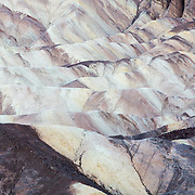 The rolling colored landscape of Zabriskie Point in Death Valley National Park, California.