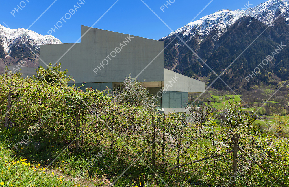 Architecture modern design, concrete house view from the meadow