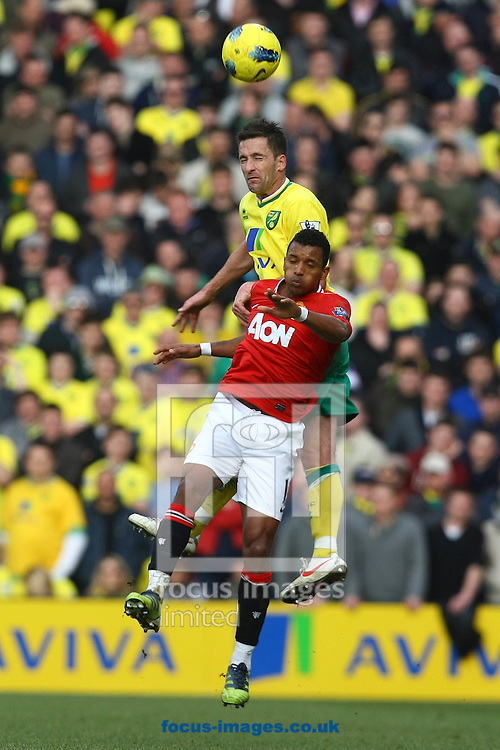 Picture by Paul Chesterton/Focus Images Ltd.  07904 640267.26/02/12.Adam Drury of Norwich and Nani of Man Utd in action during the Barclays Premier League match at Carrow Road Stadium, Norwich.