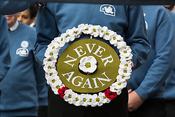London, UK. 10 November, 2019. A white poppy wreath to be laid at the Cenotaph on behalf of ex-services personnel from Veterans For Peace UK (VFP UK) taking part in the Remembrance Sunday ceremony in Whitehall. VFP UK was founded in 2011 and works to influence the foreign and defence policy of the UK for the larger purpose of world peace.