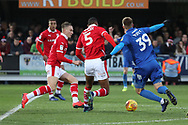 AFC Wimbledon striker Joe Pigott (39) with a sliding tackle during the EFL Sky Bet League 1 match between AFC Wimbledon and Barnsley at the Cherry Red Records Stadium, Kingston, England on 19 January 2019.