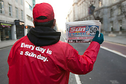 © licensed to London News Pictures. London, UK 26/02/2012. The Sun on Sunday's first edition is being sold by a newsagent in central London, this morning (26/02/12). Photo credit: Tolga Akmen/LNP