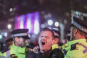 Police apprehend and arrest a Brexit supporter nearby Downing Street entrance as he was shouting racists remarks towards their colleagues in London on Jan. 31, 2020. (Photo/Vudi Xhymshiti)<br /> The UK is leaving EU meanwhile the rise of hate crime is hitting up. The Home Office saw an increase of Hate Crime in Britain in 2019 up to 11%. Transgender hate crime went up 37% to 2,333. For sexual orientation the rise was 25% to 14,491, for disability 14% to 8,256 and for religion 3% to 8,566.