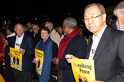 """London, October 23 2017. Nelson Mandela's group of Elders including former UN Secretary General Kofi Annan and Secretary General Ban Ki-moon accompanied by his widow Graca Machel gather at Parliament Square at the start of the Walk Together event in memory of Nelson Mandela before a candlelight vigil at his statue in Parliament Square. """"WalkTogether is a global campaign to inspire hope and compassion, celebrating communities working for the freedoms that unite us"""". PICTURED: Mary Robinson, Kofi Annan and Ban Ki-Moon at the head of the march from Trafalgar Square to Parliament Square. © Paul Davey"""