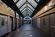Dundas Shopping Centre in Middlesborough town centre, North Yorkshire, United Kingdom.  All the shops are closed with the window shutters down.