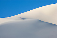 early morning sidelight on sand dune crests against the sky as part of the Eureka Dunes in the remote Eureka Valley of Death Valley National Park, California, USA