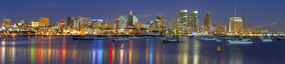 Night view of the downtown San Diego skyline looking across the harbor from the northwest. <br /> <br /> Panoramic available up to 12198x2777 pixels.