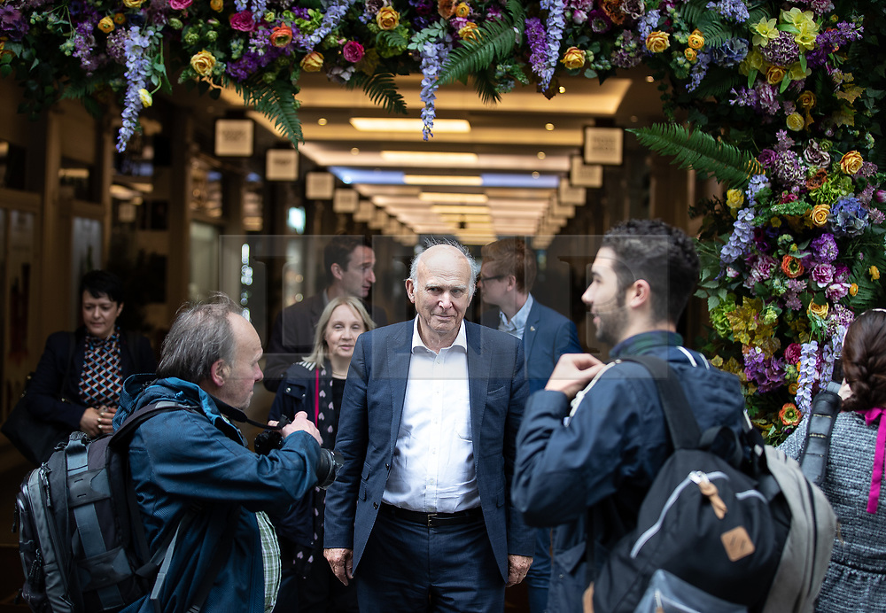 """© Licensed to London News Pictures. 20/06/2019. Manchester, UK. In one of his last actions as Liberal Democrat Party leader , SIR VINCE CABLE arrives to meet Big Issue sellers in Manchester City Centre , alongside Cllr John Leach and Jane Brophy MEP . The party say they are highlighting what they call a """" Homeless Tax """" , which they oppose , and which could see fines of up to £1,000 imposed upon the homeless by Manchester City Council . The final Local Government Information Unit (LGiU) report from the Local Government Homelessness Commission (LGHC) – a year-long initiative set up to investigate how councils can fulfil their obligation to prevent homelessness - is due to be published . The Liberal Democrats will appoint a new leader in July . Photo credit: Joel Goodman/LNP"""