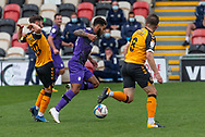 Tranmere Rover's Kaiyne Woolery under pressure from Newport County's Josh Sheehan (10) during the EFL Sky Bet League 2 match between Newport County and Tranmere Rovers at Rodney Parade, Newport, Wales on 17 October 2020.