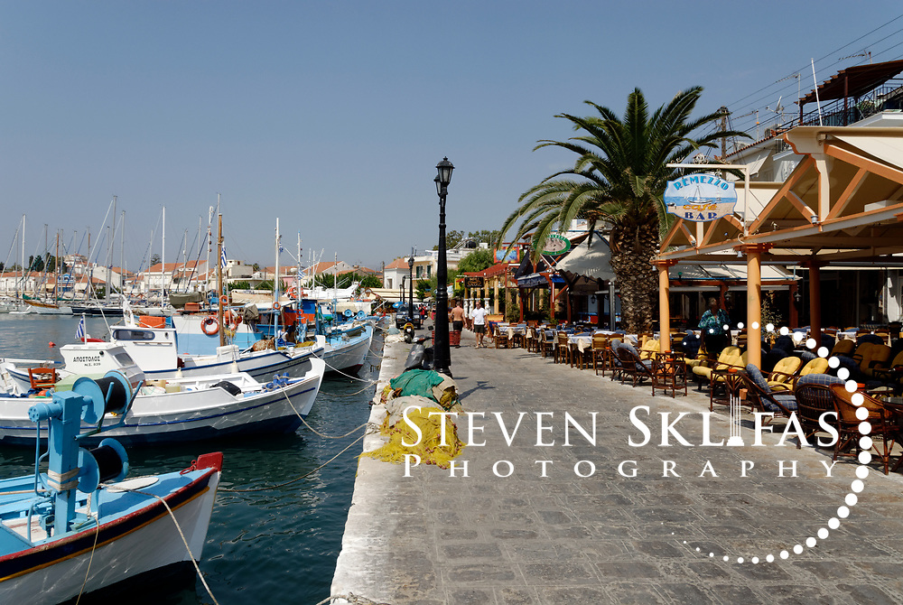 Samos. Greece. Pythagoreio waterfront bursting with restaurants and cafes and fishing boats docked in its harbour. The town of Pythagoreio is the most popular and fashionable town on the island and was named after the great philosopher Pythaogaras who was born here in 580 BC.
