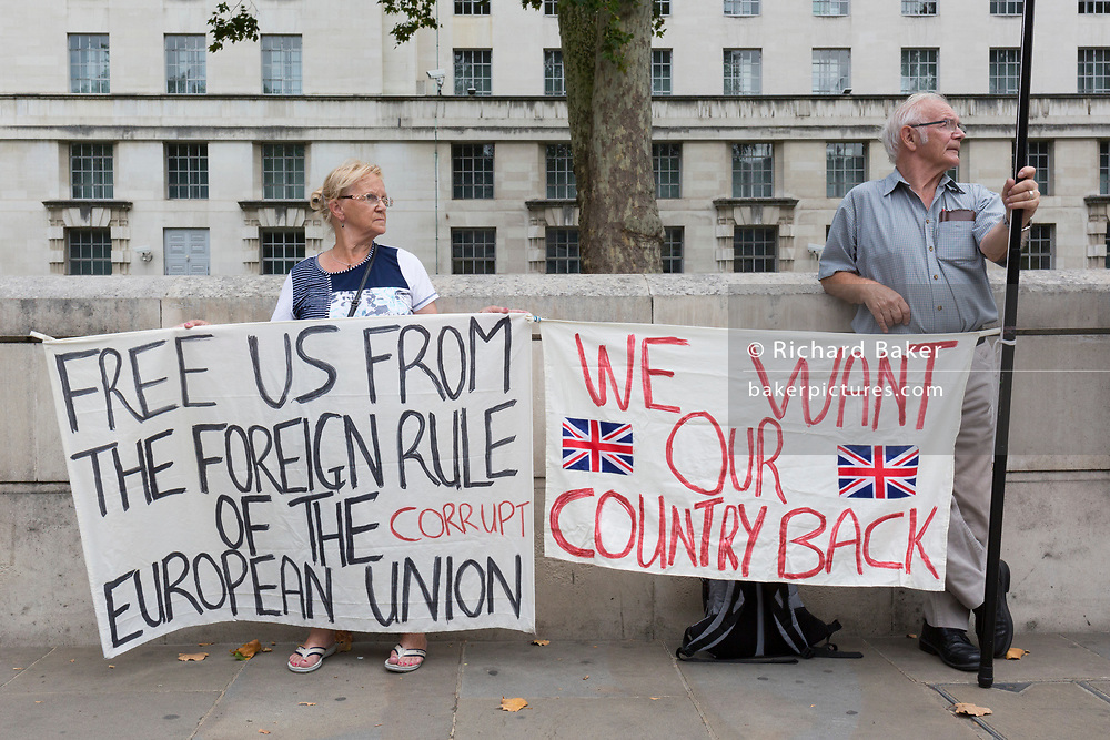On the day that British Prime Minister Boris Johnson sought to have Parliament suspended by Queen Elizabeth, days after MPs return to work in September - and only a few weeks before the Brexit deadline, Leave voters protest with their We Want Our Country Back banners opposite the Cabinet Office where daily Brexit contingency planning meetings take place, on 28th August 2019, in Whitehall, Westminster, London, England.