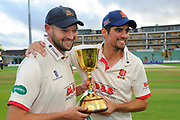 Nick Browne of Essex and Alastair Cook of Essex pose with the County Championship trophy during the Specsavers County Champ Div 1 match between Somerset County Cricket Club and Essex County Cricket Club at the Cooper Associates County Ground, Taunton, United Kingdom on 26 September 2019.