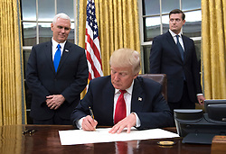 President Donald Trump signs a confirmation for Defense Secretary James Mattis in the Oval Office, at the White House in Washington, D.C. on January 20, 2017. Photo by Kevin Dietsch/UPI