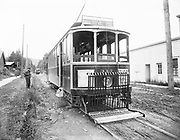 0805-B01. 16th St. Trolley, Portland. Portland Railway Company's streetcar 317 is shown heading north on NW 19th Avenue. Known as the Portland Railway Co. 'Standards', No. 317 and sister cars were all designed and built in the Portland Railway's own shops at 23rd & West Burnside. As this photo was taken, No. 317 is field-testing one of many experimental safety fender designs. (caption written by Art Greisser July 19, 2010)