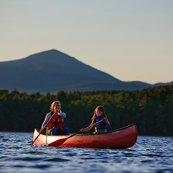 A woman and her daughter canoeing at White Lake State Park in Tamworth, New Hampshire.