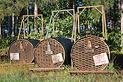 Barrel traps staged in preparation for capturing nuisance black bears in northern Wisconsin.
