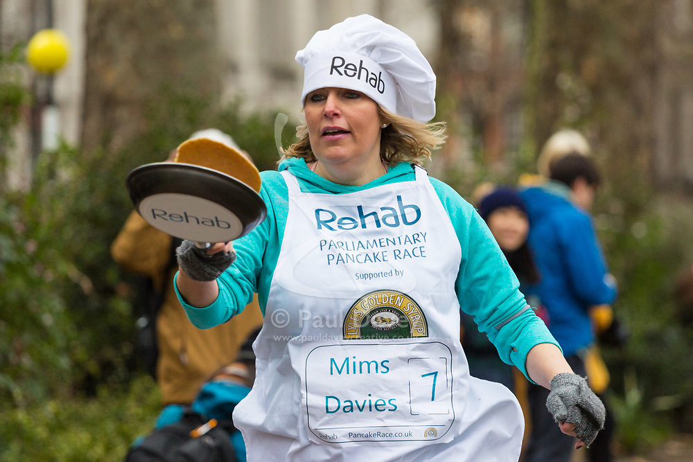 MPs and members of the House of Lords compete in the annual Rehab pancake race, a relay of eleven laps in Victoria Tower Gardens adjacent to the Houses of Parliament in London. The race is held every year on Shrove Tuesday and was won by the Media team. PICTURED: Mims Davies MP, Eastleigh.  London, February 13 2018.