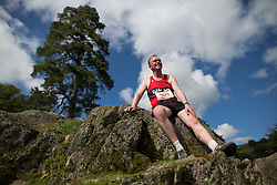 © Licensed to London News Pictures . 30/07/2015 . Ambleside , UK . TIM FARRON , newly elected leader of the Liberal Democrat Party in the UK and MP for Westmorland and Lonsdale , rests on a rocky outcrop after running in a fell race in the Lake District National Park . Photo credit: Joel Goodman/LNP