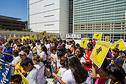 01 AUGUST 2012 - PHOENIX, AZ:      People sing and pray in front of the US Courthouse in Phoenix Wednesday. About 200 people, mostly Latino immigrants' rights and civil rights activists, gathered in front of the Sandra Day O'Connor Courthouse in Phoenix Wednesday to pray on what is expected to be the last day of testimony in the racial profiling trial against Maricopa County Sheriff Joe Arpaio. The suit, brought by the ACLU and MALDEF in federal court against Maricopa County Sheriff Joe Arpaio, alleges a wide spread pattern of racial profiling during Arpaio's ''crime suppression sweeps'' that targeted undocumented immigrants. U.S. District Judge Murray Snow granted the case class action status opening it up to all Latinos stopped by Maricopa County Sheriff's Office deputies during the crime sweeps. The case is being heard in Judge Snow's court.PHOTO BY JACK KURTZ