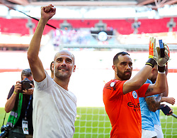 Manchester City manager Pep Guardiola waves to fans as his side celebrate winning the Community Shield with a 2-0 victory over Chelsea - Rogan/JMP - 05/08/2018 - FOOTBALL - Wembley Stadium - London, England - Chelsea v Manchester City - The FA Community Shield.