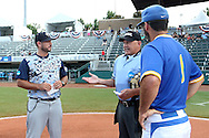 31 May 2016: Home plate umpire Darryn Fredrickson (center) explains the ground rules to Nova Southeastern head coach Greg Brown (44) and Lander head coach Kermit Smith (1). The Nova Southeastern University Sharks played the Lander University Bearcats in Game 8 of the 2016 NCAA Division II College World Series  at Coleman Field at the USA Baseball National Training Complex in Cary, North Carolina. Nova Southeastern won the game 12-1.