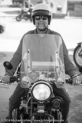 John Landstrom at a gas stop on his 1928 BMW R62 during Stage 5 of the Motorcycle Cannonball Cross-Country Endurance Run, which on this day ran from Clarksville, TN to Cape Girardeau, MO., USA. Tuesday, September 9, 2014.  Photography ©2014 Michael Lichter.
