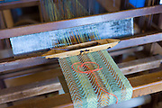 Traditional loom with bobbin producing 100% lambswool woolen scarf at Croft Wools and Weavers, Applecross in the Highlands of Scotland