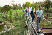 Visitors walk on an elevated footbridge over the enclosure at the Sun Bear Sanctuary run by the Borneo Orangutan Survival Foundation in the Samboja Lestari conservation area in Kutai Kartanegara district, East Kalimantan, Indonesia, on March 13, 2016. <br /> (Photo: Rodrigo Ordonez)