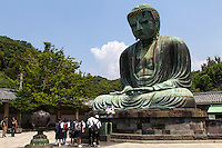 Great Buddha of Kamakura - a monumental  bronze statue of Buddha  was built in 1252. The bronze image was cast by Ono Goroemon who was a leading maker at that period of time.   There are traces of gold leaf near the statue's ears as the entire statue was once gilded.  The hall in which the Daibutsu was housed was destroyed by a storm in 1334, then rebuilt, then  damaged by yet another storm in 1369.  It was  rebuilt sa third time but the last building washed away in the tsunami of September 1498.  Since then, the Great Buddha has stood in the open, as it is today.