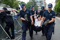 July 20, 2017 - Warsaw, Poland - Policemen carry a protester away from a demonstration in front of the Sejm (Lower House of Polish Parliament) building in Warsaw, Poland on 20 July 2017. People protest against controversial and possibly illegal changes in the judicial law and the Supreme Court, which were passed today by the Law and Justice's majority in Sejm. (Credit Image: © Mateusz Wlodarczyk/NurPhoto via ZUMA Press)