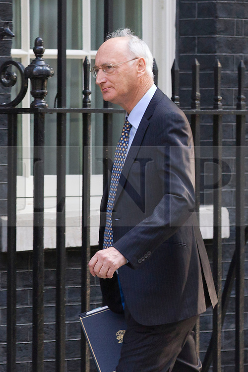 "© Licensed to London News Pictures. 29/08/2013. London, UK. The Chief Whip Sir George Young arrives for a meeting of the British cabinet on Downing Street in London today (29/08/2013) as a recalled British Parliament prepares to debate the possibility of ""direct"" military action over recent reports an alleged chemical weapons attack in Syria. Photo credit: Matt Cetti-Roberts/LNP"
