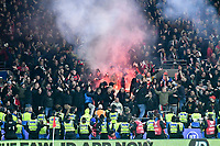Football - 2019 / 2020 UEFA European Championships Qualifier - Group E: Wales vs. Hungary<br /> <br /> hungary fans let off a red flare police in foreground  , at Cardiff City Stadium.<br /> <br /> COLORSPORT/WINSTON BYNORTH