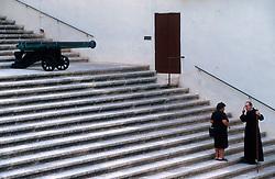 MALTA GOZO VICTORIA JUL00 - A Catholic priest debates with a Maltese lady on the stairs to the Citadella in Victoria.. . jre/Photo by Jiri Rezac. . © Jiri Rezac 2000. . Tel:   +44 (0) 7050 110 417. Email: info@jirirezac.com. Web:   www.jirirezac.com