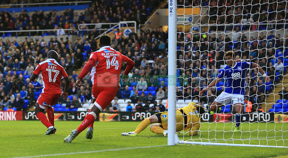 Birmingham City's Che Adams (right) scores his side's third goal of the game against Crawley Town