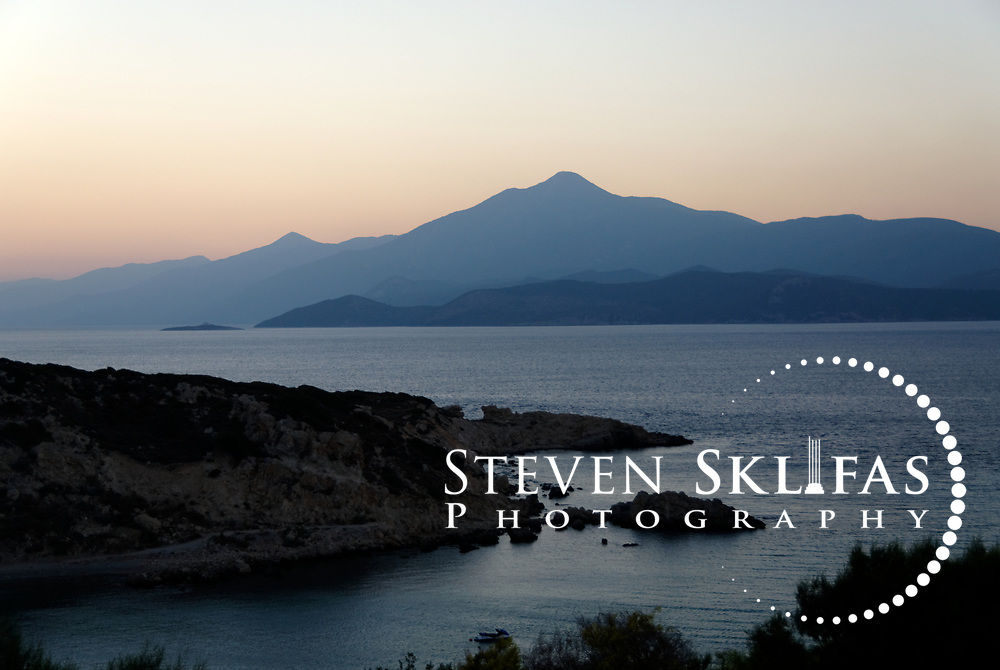 Samos. Greece. Seascape view at dusk of the Aegean Sea near the town of Pythagoreio on the south east side of Samos. In the distance are the mountains of western Turkey.
