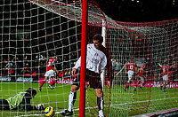 Fotball<br /> Premier League England 2004/2005<br /> Foto: BPI/Digitalsport<br /> NORWAY ONLY<br /> <br /> Charlton Athletic v Fulham <br /> FA Barclays Premiership<br /> 20/12/2004<br /> <br /> Fulham's Ian Pearce picks up the ball as Charlton celebrate the second from Talal El Karkouri