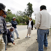 SAN DIEGO, CA, MAY 4, 2007:  Day laborers gather in hopes of finding temporary work in San Diego, California on May 4, 2007. The migrant workers, mostly from Mexico, stand on street corners and in deserted lots where contractors and homeowners come looking for cheap labor. Claudia Smith, a well known activist with the California Rural Legal Assistance, advises the migrants on avoiding conflicts with anti-immigration advocates who target the migrant labor sites. (Photo by Todd Bigelow/Aurora) Please contact Todd Bigelow directly with your licensing requests.