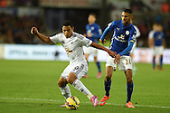 Jefferson Montero of Swansea city breaks away from Leicester's Riyad Mahrez. Barclays Premier league match, Swansea city v Leicester city at the Liberty stadium in Swansea, South Wales on Saturday 25th October 2014<br /> pic by Andrew Orchard, Andrew Orchard sports photography.