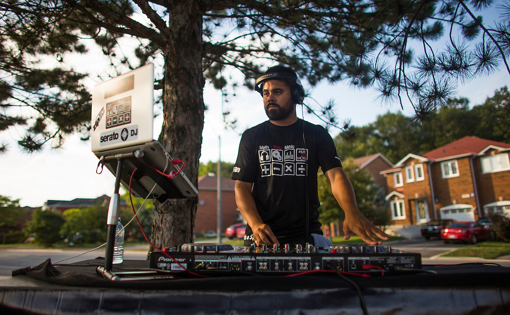 Mississauga , Ontario - August 19, 2015 -- Basketball -- DJ Director plays music on a temporary basketball court set up by the Erin Mills Youth Centre during a community event in a parking lot in Mississauga, Thursday August 19, 2015   (Mark Blinch for the Globe and Mail)