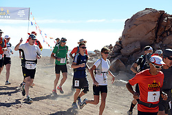 © Licensed to London News Pictures. 14/11/2013.<br /> <br /> British mother and son pair Yvonne & Connor brown, bibs no. 6 &5. <br /> <br /> Inaugural Volcano Marathon, Atacama Desert, Chile. The race took place in the Atacama Desert in Chile, beginning at an altitude of 4,400 metres (14,500 feet) in the vicinity of Lascar Volcano. It was a gruelling affair for many of the competitors who had to encounter some challenging hills and manage the impact of the heat and oxygen deprivation. The average altitude of the entire race was close to 4,000 metres and temperatures reached the mid 20s Celsius, or almost 80 Degrees Farenheit.<br /> <br /> Photo credit : Mike King/LNP<br /> <br /> Further information and link to video here: https://www.dropbox.com/s/0277bepxvo0t8il/Marathon%20copy.txt