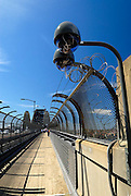 Security cameras on the footpath approaching the Sydney Harbour Bridge. Sydney, Australia